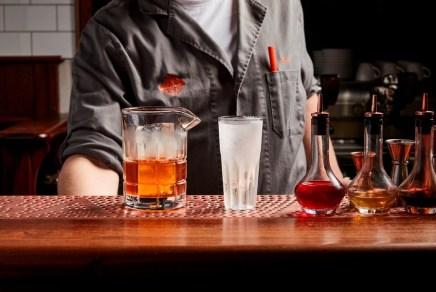 bartender making cocktails and nagroni drinks at americano bar