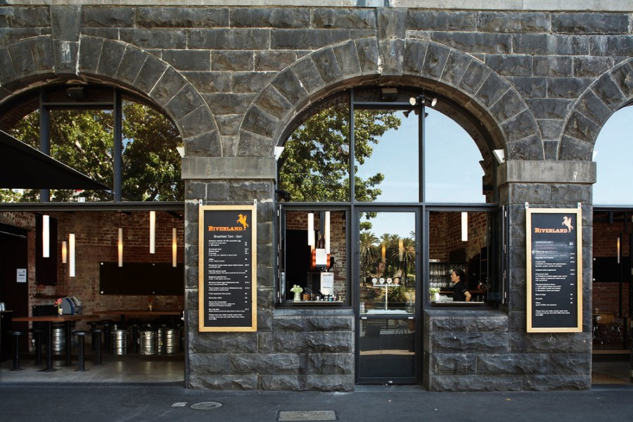 outside of riverland wharf vault's stone walls and arches with dinner menu on wall