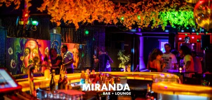 couples drinking on happy hour friday night with vibrant atmosphere at miranda bar