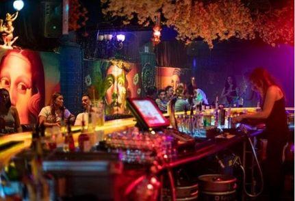 female staff serving drinks at melbourne miranda bar on saturday salsa night