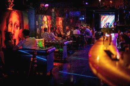 patrons seated at booths in melboune miranda basement nightclub on flinders lane