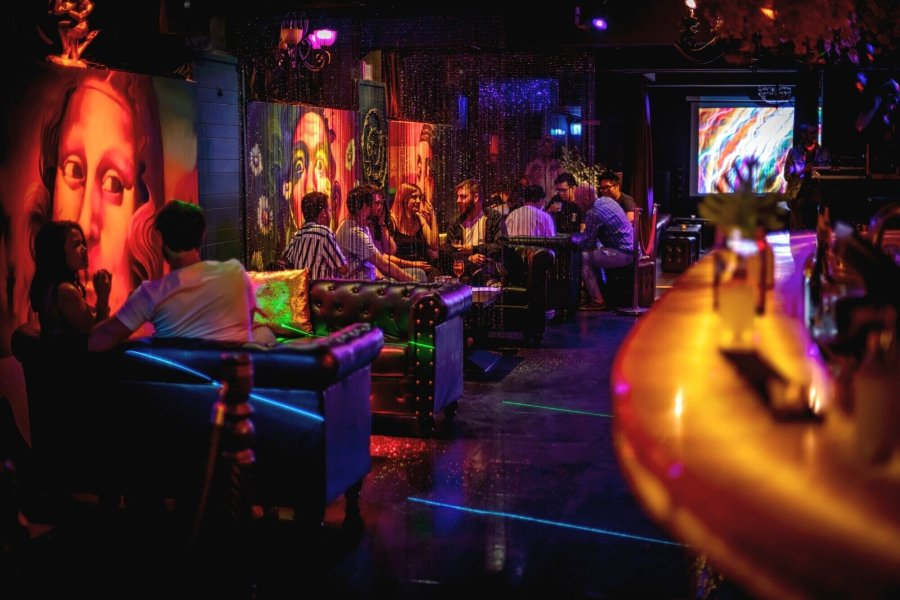 people drinking in miranda bar's booths in decorative nightclub