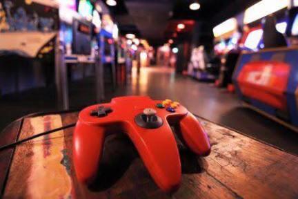 red nintendo 64 controller in arcade
