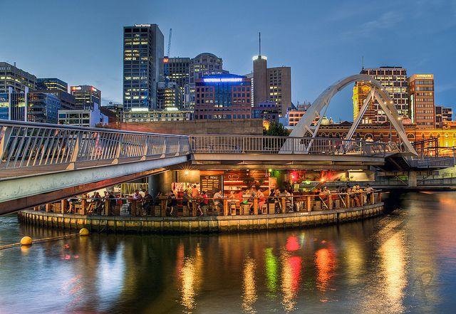 floating bar under bridge on melbourne's yarra river