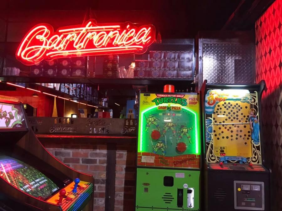 bartronica main bar counter with teenage mutant ninga turtle retro arcade game and red neon light