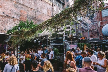 crowds day drinking at section 8 melbourne laneway bar under plants