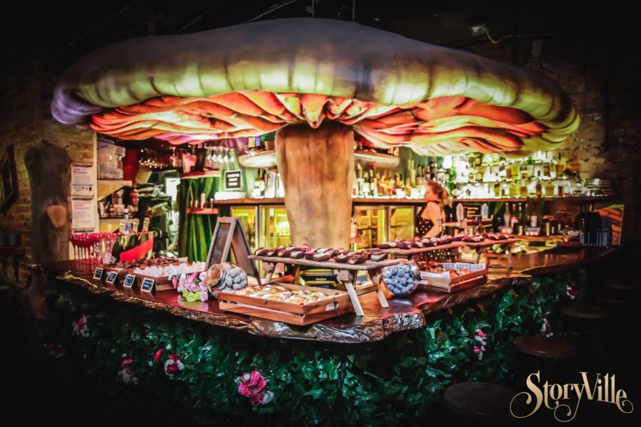 main downstairs magical mushroom bar at stroyville with staff making drink