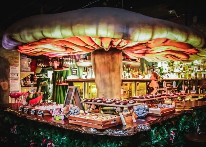 giant mushroom fairy tale themed bar at storyville
