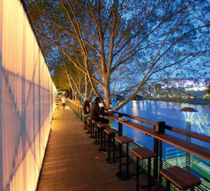 flinders river walk with seating along arbory bar next to yarra river with trees