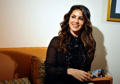 Indo-Canadian actress Sunny Leone poses during the grand finale of the AdictionDeo Contest in Mumbai