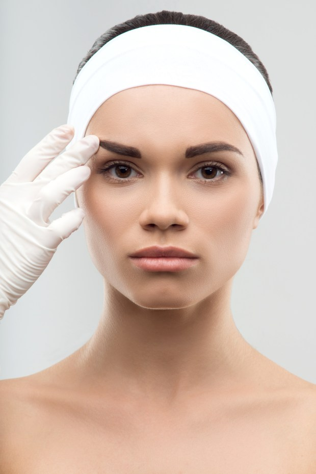 http://www.dreamstime.com/royalty-free-stock-image-measuring-correct-proportion-eyebrows-closeup-portrait-young-attractive-woman-being-measured-surgeon-gloves-plastic-image42796686