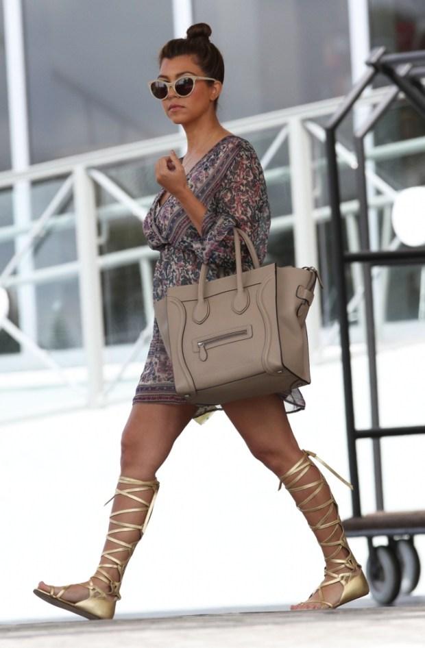 Kourtney-Kardashian-Shows-Off-Lean-Post-Baby-Body-in-Miami-2-671×1024