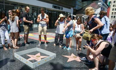 vCurrently residing in Los Angeles, many know him as the artist who built a tiny wall around Trump's star on the Hollywood walk of fame.