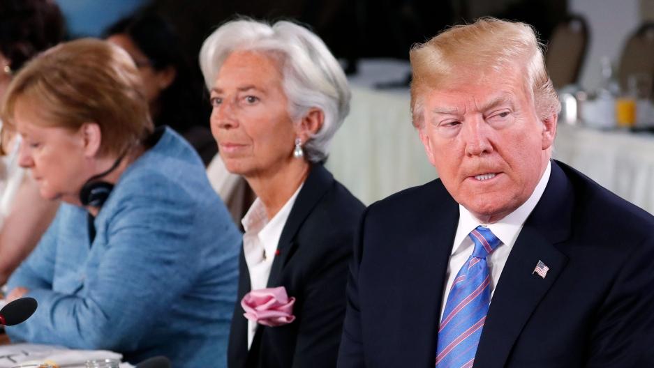July 2018 Trump Merk. Lagarde (Yves Herman:Reuters)