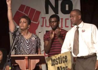 Jeralynn and Adam Blueford (at left and right) onstage at a Bay Area meeting against police violence (WeAreMany.org)