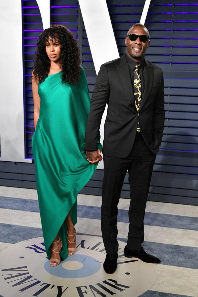 Sabrina Dhowre and Idris Elba 2019 Vanity Fair Oscar Party Hosted By Radhika Jones - Arrivals