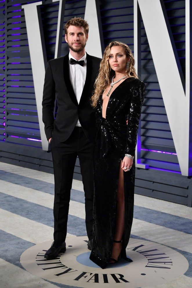 Miley Cyrus and Liam Hemsworth 2019 Vanity Fair Oscar Party Hosted By Radhika Jones - Arrivals