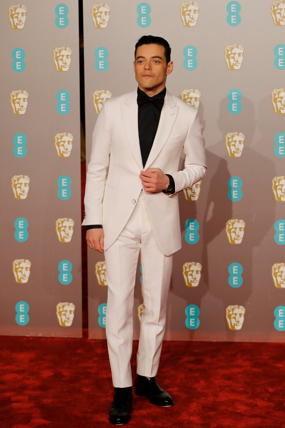 Rami Malek poses on the red carpet upon arrival at the BAFTA British Academy Film Awards