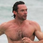 Hugh Jackman shows off his muscles during an early morning dip at Bondi Beach