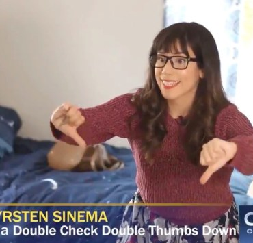 Senator Kyrsten Sinema seen practicing her $15 minimum wage 'no' vote