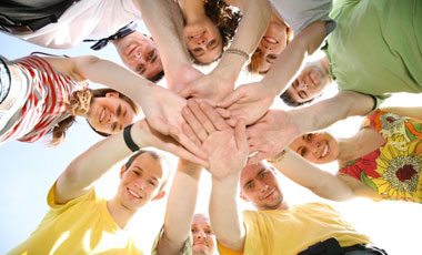 Team die die Haende zusammenlegen - Sportsgeist