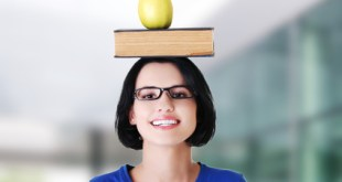 Woman holding an apple on head