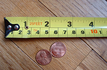 A typical tape measure with both metric and US...