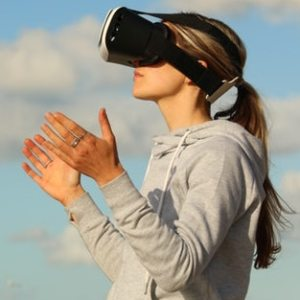 woman wearing virtual reality headset outside