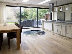 White-Spiral-Cellar-with-retractable-round-glass-door-kitchen-4