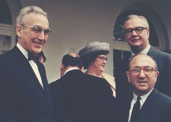 Wilbur Cohen is shown here at the White House during the Johnson Administration with (l) Arthur Altmeyer and (r) Robert M. Ball.