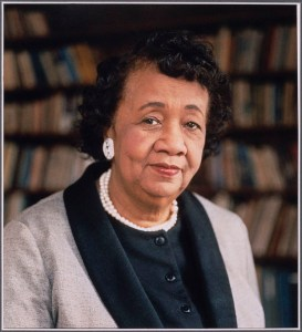 Portrait of Dorothy Height seated before a bookcase