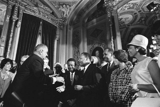 President Lyndon B. Johnson, Martin Luther Kind, Jr. and Rosa Parks at the signing of the Voting Rights Act on August 6, 1965