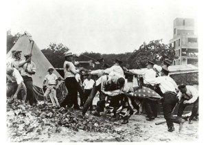 """Bonus Marchers"" and police battle in Washington, DC. The marchers came to Washington, DC, to demand their veterans ""bonus"" payment early from Congress. After several months of camping near the Anacostia River and after several confrontations with police, federal, troops drove the marchers from the city."