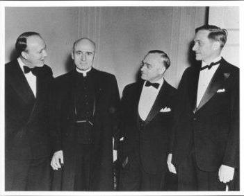 Associate Justices of the Supreme Court Hugo Black, Felix Frankfurter, and William O. Douglas (left to right) with Monsignor John A. Ryan (second from the left) at his 70th birthday testimonial dinner (May 25, 1939)