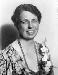 Eleanor Roosevelt wearing a flower print dress and a corsage
