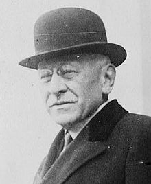 Julius Rosenwald (1862 - 1932) wearing a bowler hat and topcoat