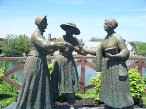 Life sized statues of Amelia Bloomer, Susan B. Anthony, and Elizabeth Cady Stanton. Posed as if it were a scene taking place before us.