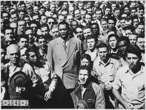 Paul Robeson, world famous baritone, leading Moore Shipyard workers in singing the Star Spangled Banner, 1942