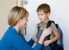 Mom with Son Wearing Backpack 1