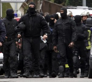 252311-masked-french-special-unit-policemen-leave-after-the-assault-to-captur