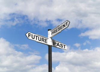 "Road sign that says ""past, present, and future"""