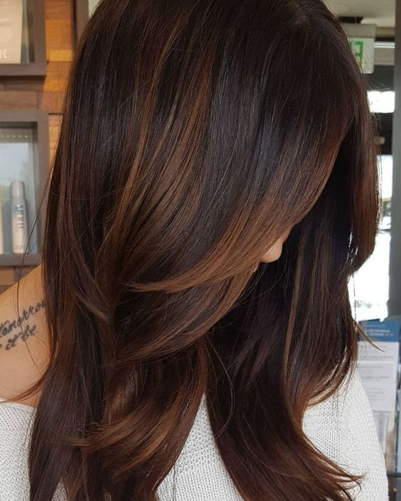 A warm brown balayage plays up the natural highlights you may get from the summer sun