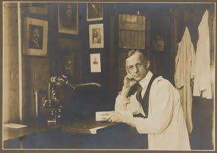Founding member of the Society of Clinical Surgery Harvey Cushing, M.D., works at his desk in 1907.