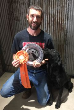 Ken Youngs with Blake, who passed AKC's Master National Level Hunt Test in 2016. Photo by Linda Lane.