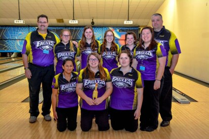 The Schoolcraft girls' bowling team placed fourth in the state tournament. They are from left to right: Back row: Coach Mark Blentlinger, Shelbe Bruystens, Kira Wright, Chloe Baldwin, Katelyn Robertson, Coach Eric West Front row: Gurjot Nanhra, Megan West, Toni Schimmel, Coach Ally West. They are featuring the rubber chicken, Rodney, held by Megan West. Photos by Stephanie Blentlinger, Lingering Memories Photography.