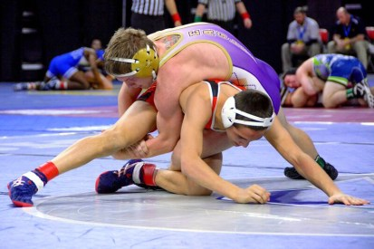 Spencer Fox attempts a take-down of his opponent in an early round of the state finals. He finished third in his weight class. Photos by Stephanie Blentlinger, Lingering Memories Photography.