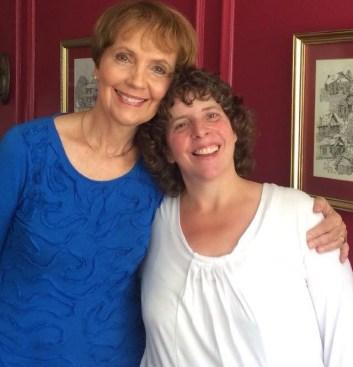 Book author, Laurel Macon, hugs her protégé Lorie Williams.
