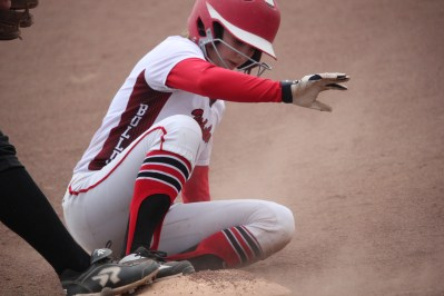 Kali Yant slides safely into third base during a double header win over Paw Paw in April.