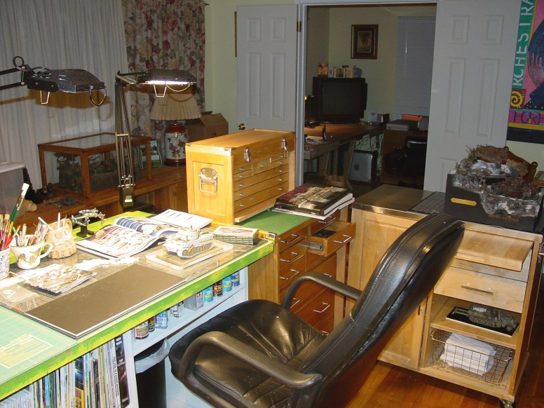 In the background is my old home office with a huge computer monitor.