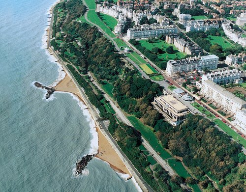 Marvelous bird's eye view of the Leas. Visible is the Leas Cliff Pavillion, the Clifton Hotel and at the other end of the garden can be seen the View Hotel